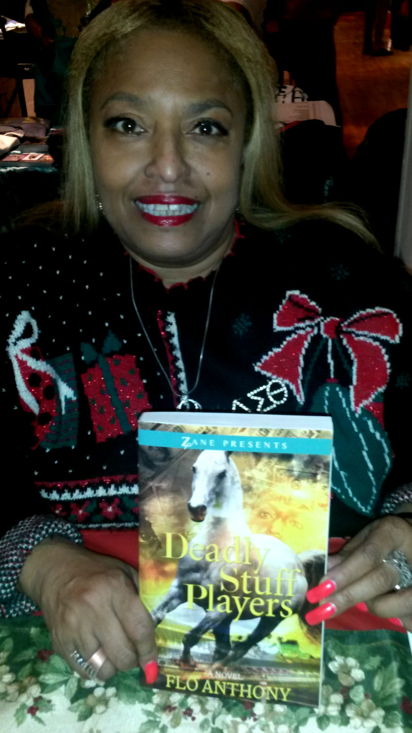 Ms. Flo Anthony of TV1 notoriety here at Black Expo with her second tome Deadly Stuff Players a blac