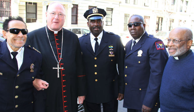 5486  L-R  Chief Saliah of 5 Star Security THE Cardinal Timothy Dolan friend Michael A. Davidson- De