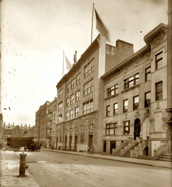 the building with the statue is the Our Lady of Lourdes School at 468 West 143rd Street in New York circa 1914