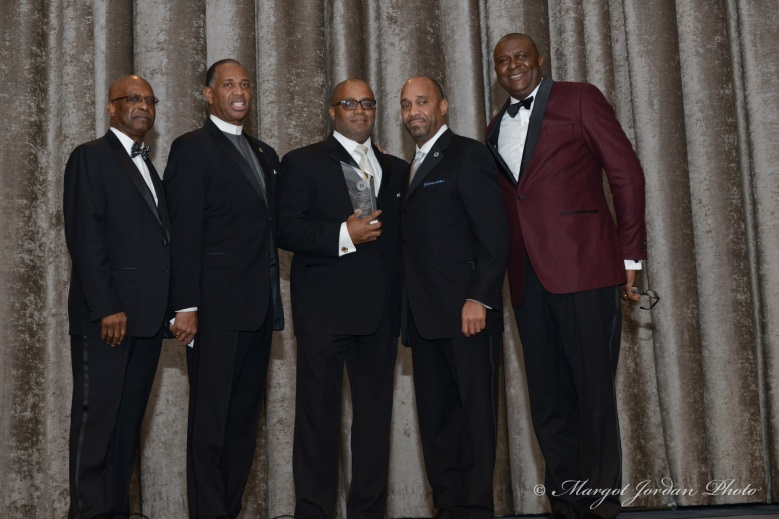 Will Brown Jr., Gala Co-Chair; Rev. Jacques Andre DeGraff; Phil Banks III, Honoree;