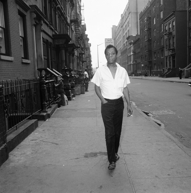 In his speech and writings, James Baldwin describes a bleak, lonely, hungry exile in which he and all American blacks, whatever their station and fortune, go from dawn to dusk in constant terror. His early exile began in Harlem's streets which he later said were filled with beautiful black people despoiled by the pressure of the white world. He is shown walking on a street in New York, June 19, 1963. (AP Photo/Dave Pickoff)